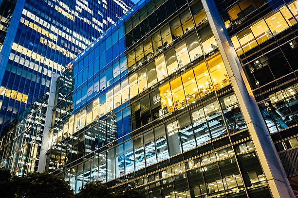 Illuminated office buildings at Canary Wharf, London at Night stock photo