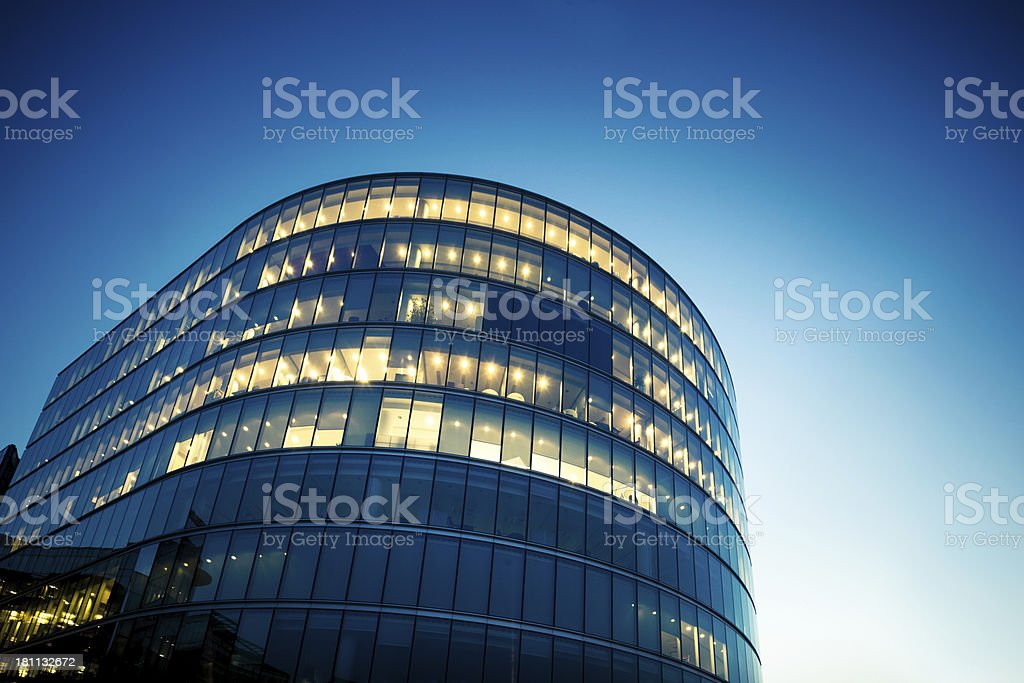 Illuminated Office Buildings at Night in London royalty-free stock photo