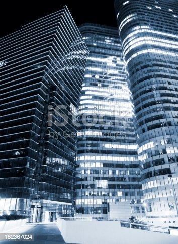 889637894 istock photo Illuminated Office Buildings at Night, Toned Image 182367024