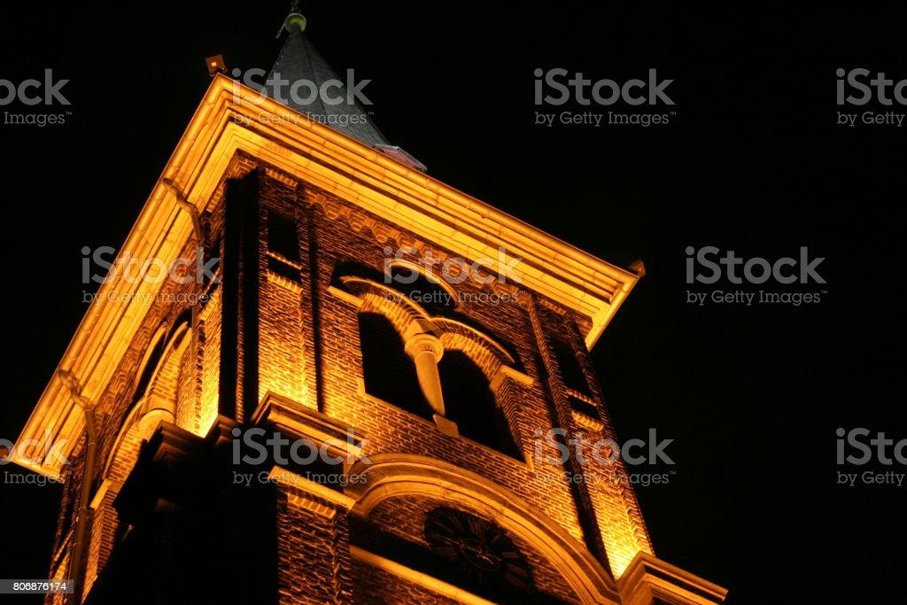 illuminated old church at night stock photo