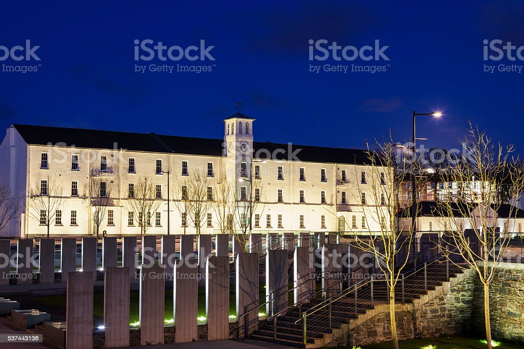 Illuminated old town of Derry stock photo