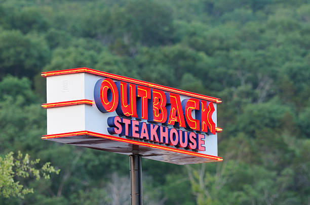 Illuminated Outback Steakhouse sign. stock photo