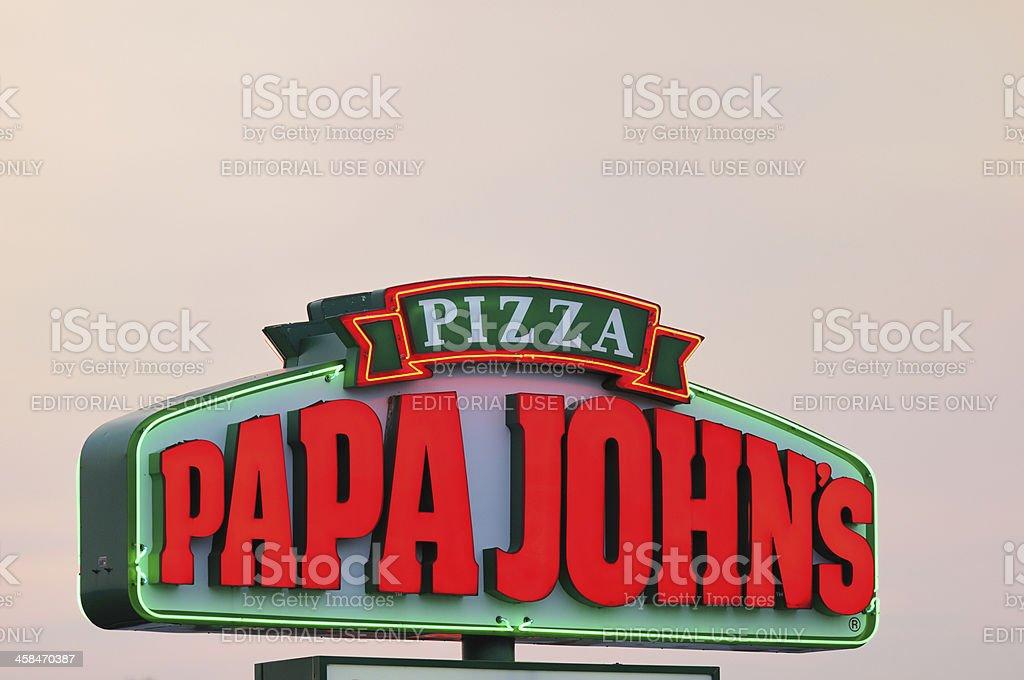 Illuminated Papa John's Pizza Sign at Sunset royalty-free stock photo