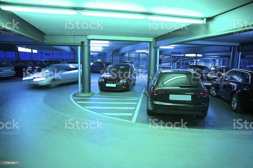 Illuminated Parking Garage with Cars stock photo