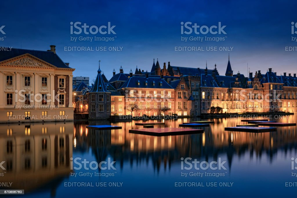 illuminated parliament buildings in The Hague at dusk stock photo
