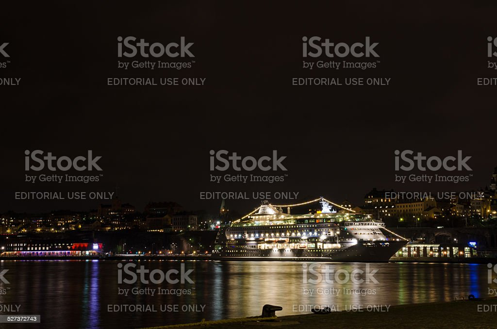 Illuminated passenger cruise ship. stock photo