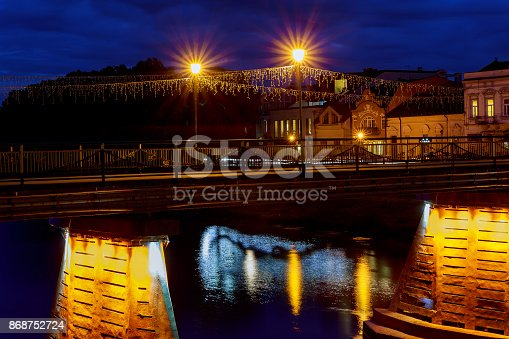 istock Illuminated pedestrian bridge in the center of Uzhgorod the evening, Ukraine 868752724