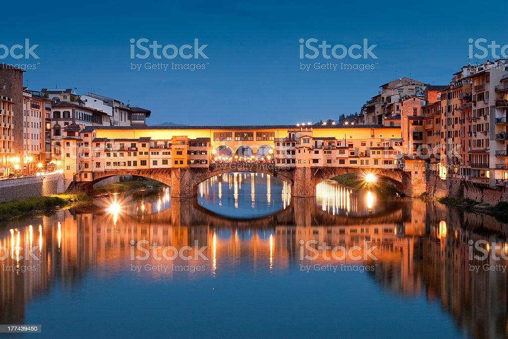 Illuminated Ponte Vecchio at night stock photo