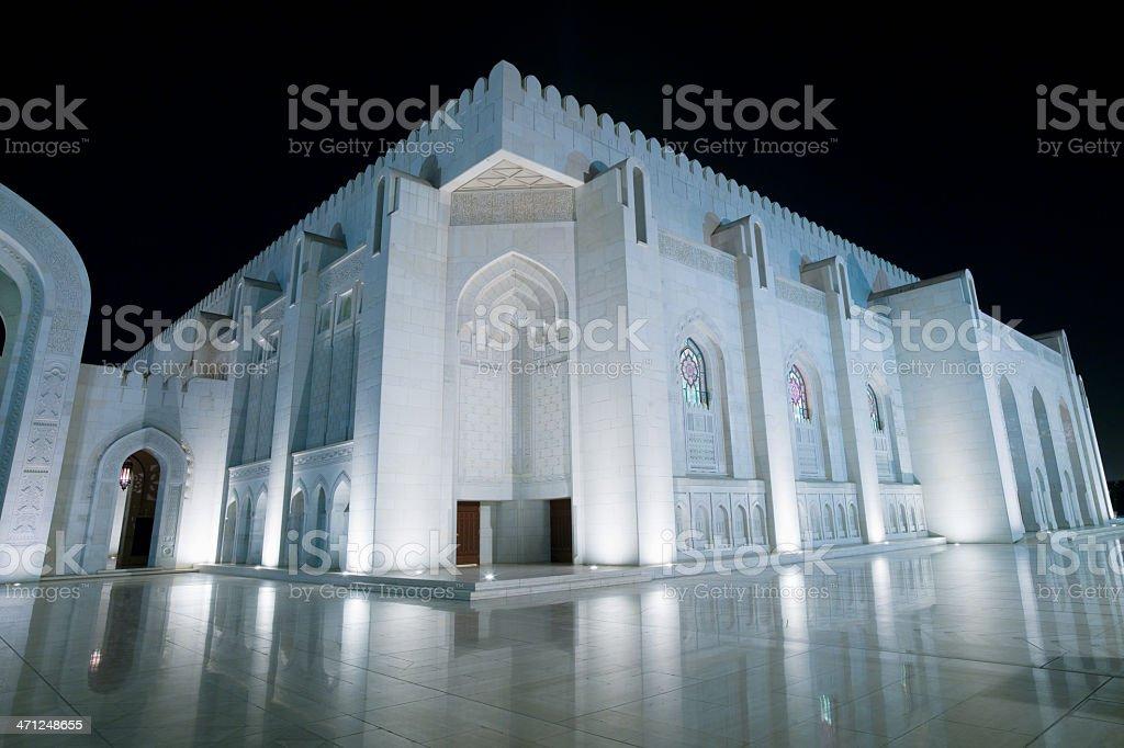 Illuminated Prayer Hall of Grand Mosque Sultan Qaboos royalty-free stock photo
