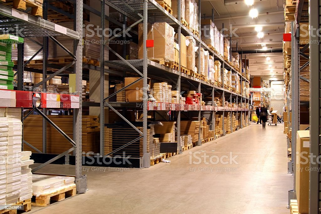 Illuminated retail warehouse racking with stacked boxes royalty-free stock photo