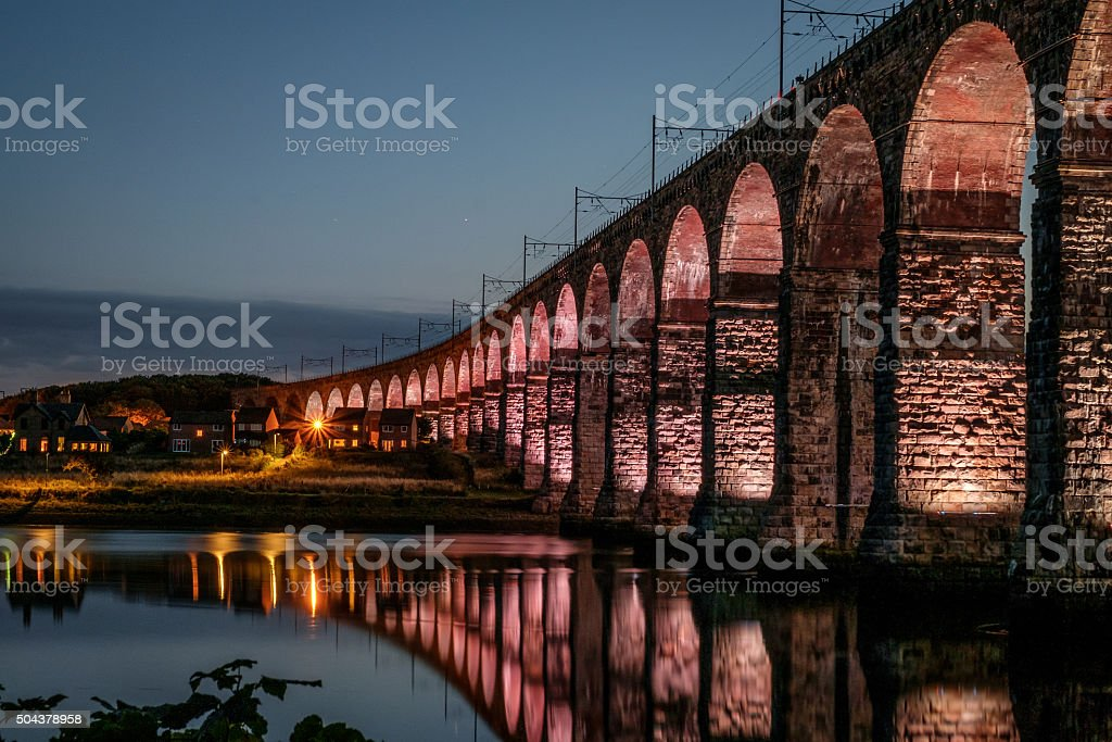 Illuminated Royal Border Bridge over the River Tweed stock photo