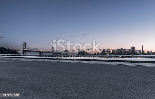 istock illuminated san francisco downtown skyline with empty highway on foreground 817241458