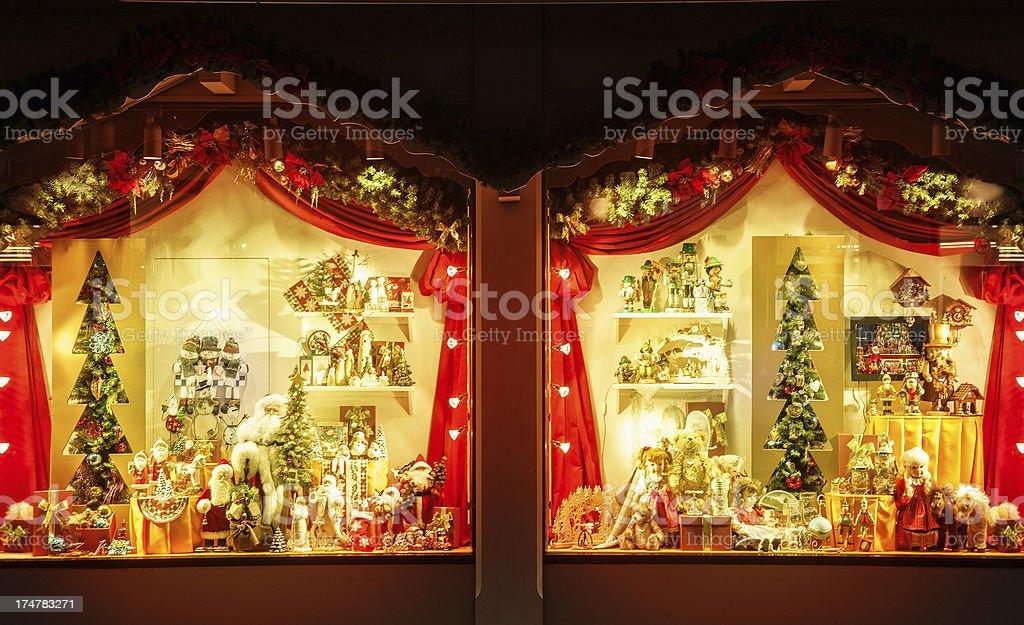 Illuminated shop windows decorated for christmas stock photo
