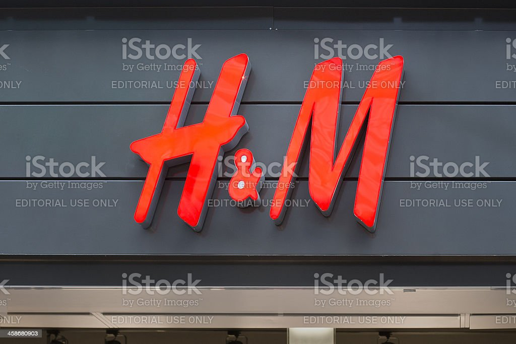 Illuminated sign of H&M in Wiesbaden, Germany stock photo
