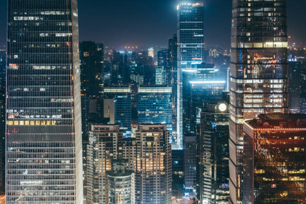 illuminated skyscrapers - urban sprawl stock photos and pictures