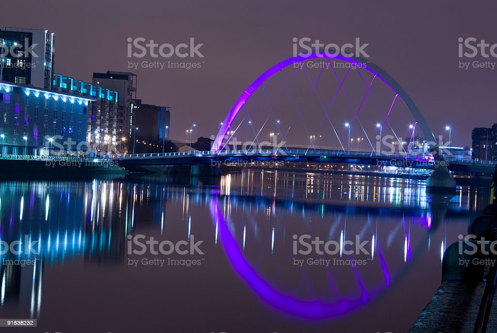 Illuminated Squinty Bridge crossing the River Clyde, Glasgow, Scotland. royalty-free stock photo