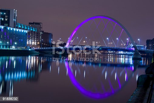 istock Illuminated Squinty Bridge crossing the River Clyde, Glasgow, Scotland. 91838232