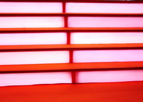 beleuchtete treppen - universum city kinos stock-fotos und bilder