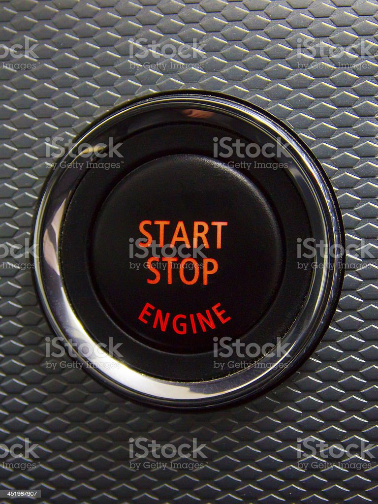 Illuminated Start Stop engine button in a sport car stock photo
