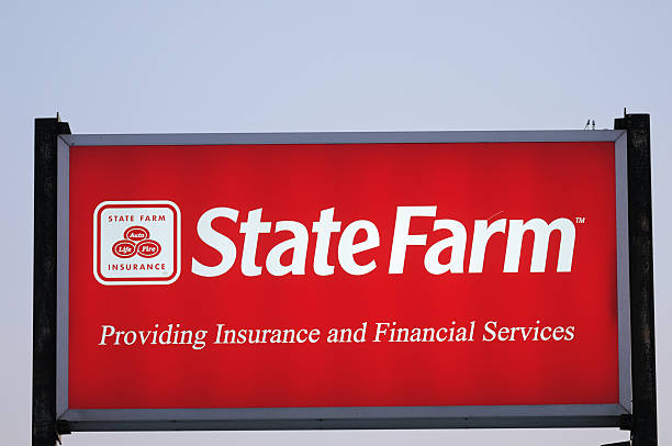 Illuminated State Farm Insurance sign with copy space stock photo
