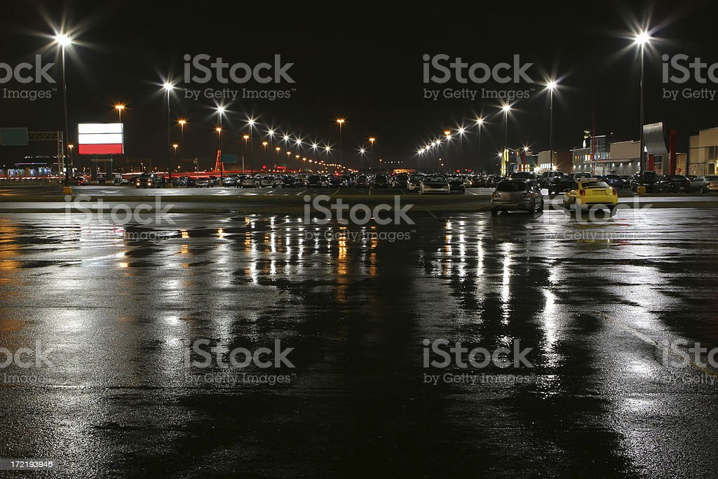 Illuminated Stores Parking at Night stock photo