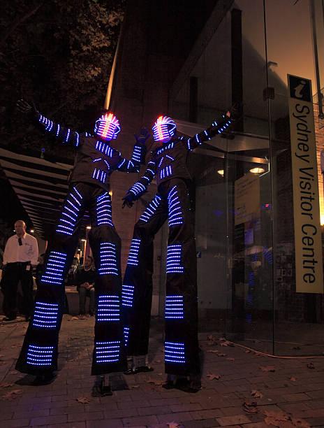 illuminated street performers,  stilt walkers for sydney vivid a - tron sci fi bildbanksfoton och bilder