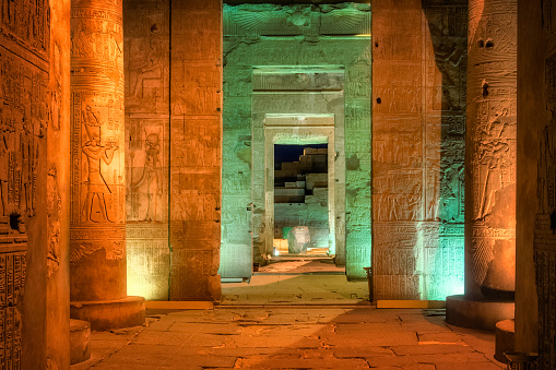 The Temple of Kom Ombo is an unusual double temple in the town of Kom Ombo in Aswan Governorate, Upper Egypt. It was constructed during the Ptolemaic dynasty, 180–47 BC. Some additions to it were later made during the Roman period. The building is unique because its 'double' design meant that there were courts, halls, sanctuaries and rooms duplicated for two sets of gods.
