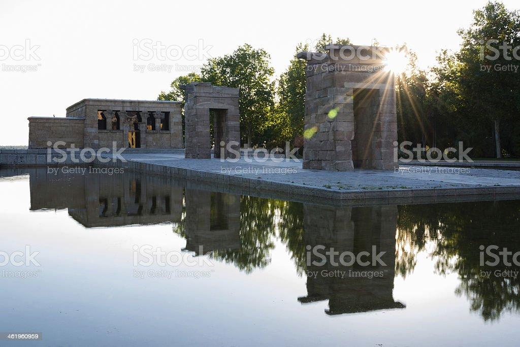 Illuminated templo de Debod and reflection at dusk in Madrid stock photo