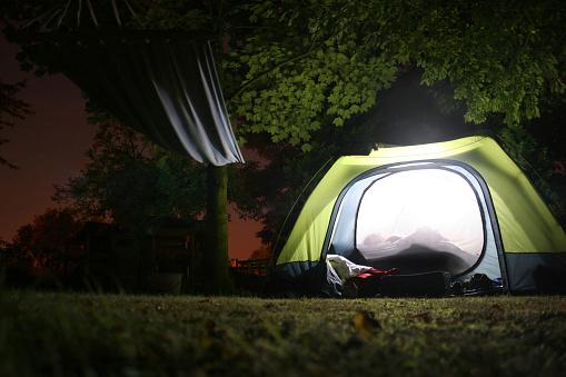 Illuminated tent and hamock at night