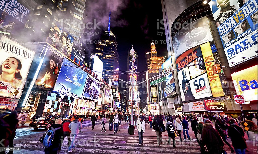 Illuminated Times Square at evening stock photo