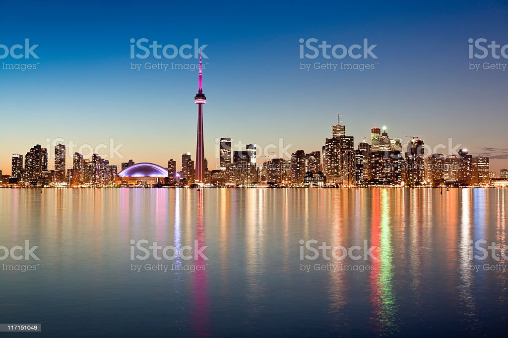 Illuminated Toronto skyline as seen from across the water royalty-free stock photo