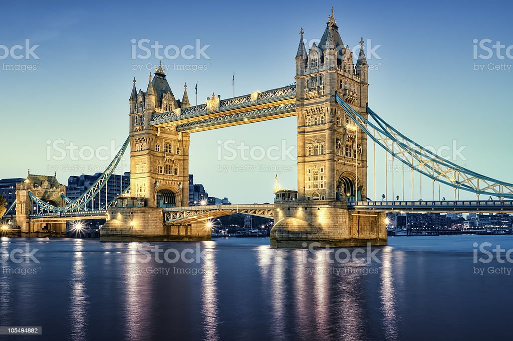 Illuminated Tower Bridge in London as seen at night stock photo