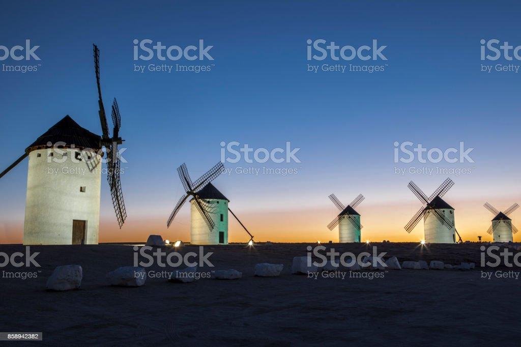 Illuminated traditional windmills at rising stock photo