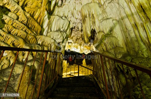 Illuminated underground corridor through the cave with a lot of beautiful decorations, Homolje mountains, east Serbia