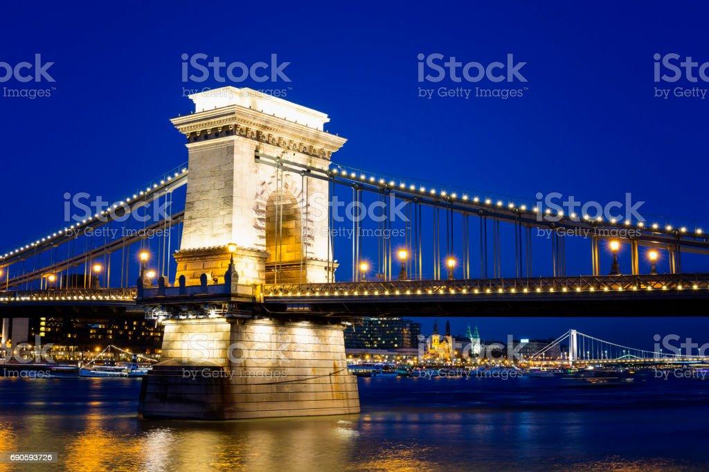 Illuminated view of Chain Bridge, Elizabeth Bridge and Liberty Bridge in Budapest at night stock photo