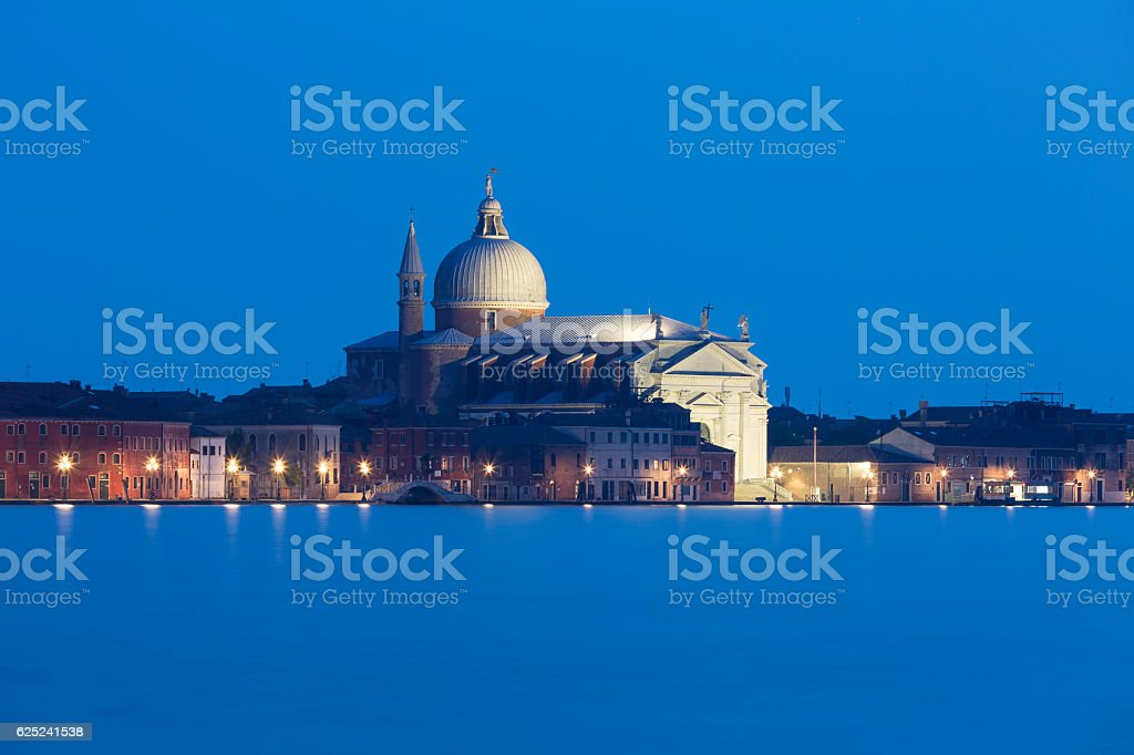 Illuminated view of Il Redentore church at dusk stock photo