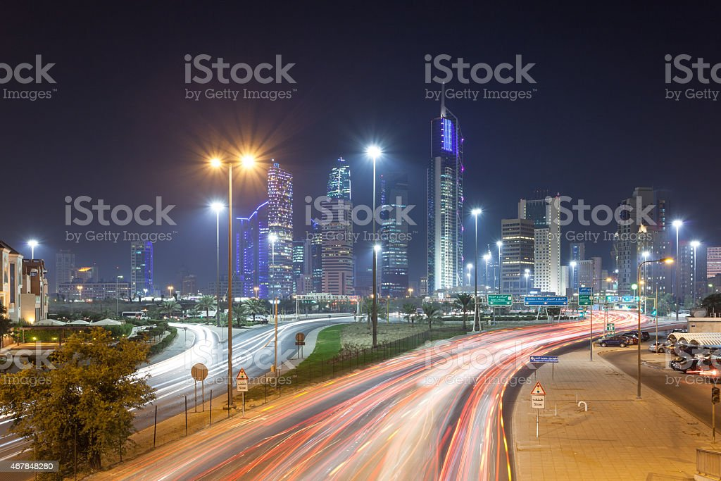 Illuminated view of Kuwait City's cityscape stock photo