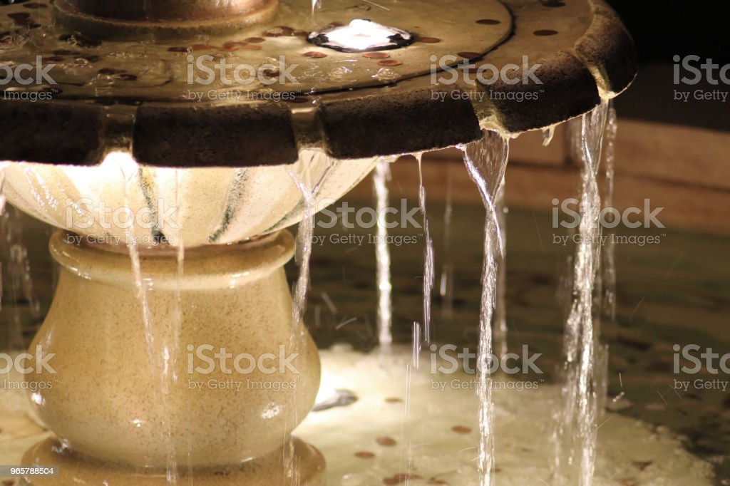 Illuminated water fountain with coins - Royalty-free Beauty Stock Photo