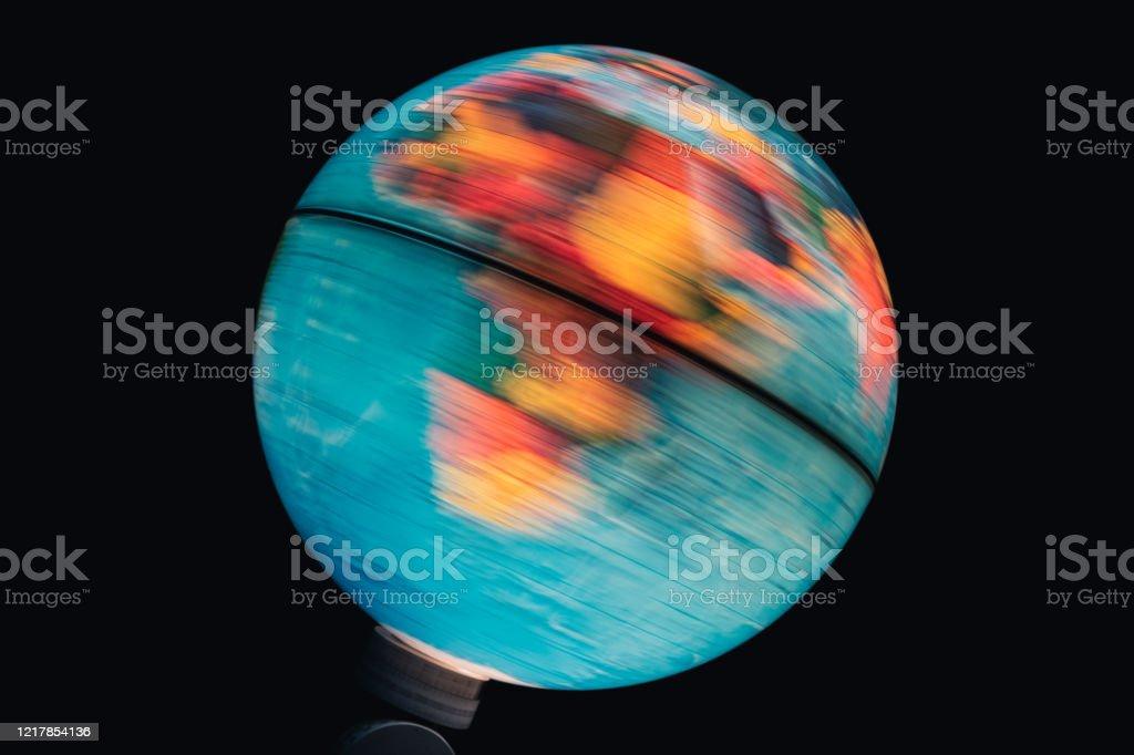 Illuminated world globe spinning with black background Illuminated world globe spinning with black background Blue Stock Photo