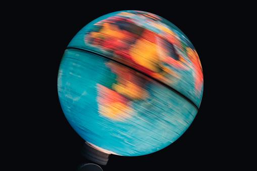 Illuminated World Globe Spinning With Black Background Stock Photo - Download Image Now