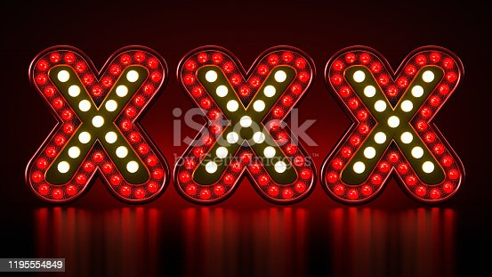 Illuminated XXX letters standing on black surface.