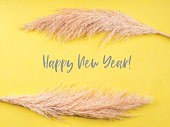 Illuminated yellow happy new year greeting card. Boho style