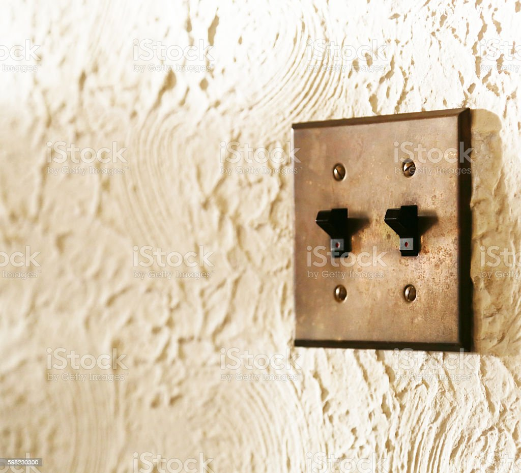Illumination switch of the white wall foto royalty-free
