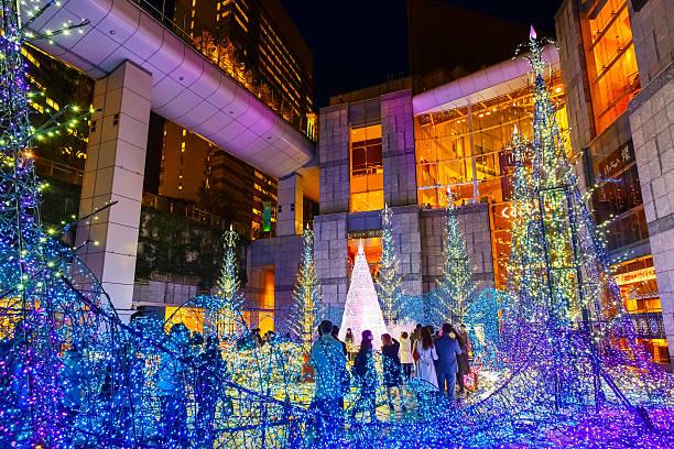 illuminations light up at at caretta shopping mall - weihnachten japan stock-fotos und bilder