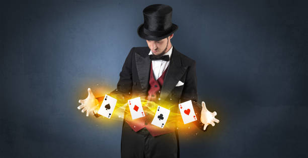 Illusionist making trick with magical play cards Illusionist in tails bandy play cards between his two hands magic trick stock pictures, royalty-free photos & images