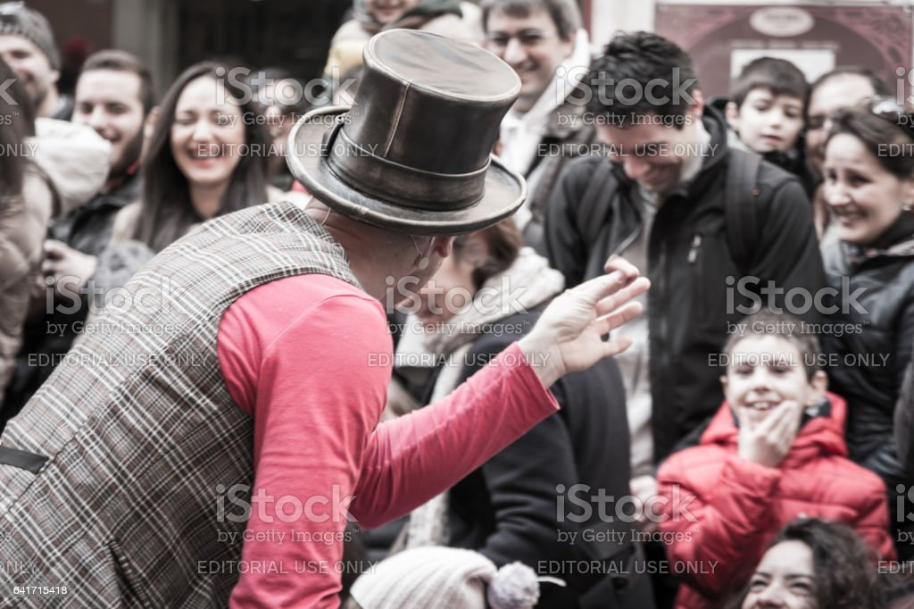 Parma, Italy - March 2015:illusionist with magician's hat during street performance in Public Location, rear view stock photo