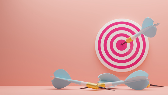 3D illustration. Blue Arrow hitting the center of target on the wall. Arrows that missed the target lie on the floor.Success business concept . Render