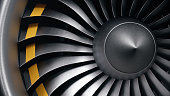 istock 3D illustration jet engine, close-up view jet engine blades. Front view of a jet engine blades. Rotating blades of the turbojet. Part of the airplane. Blades at the ends painted orange 1153489383