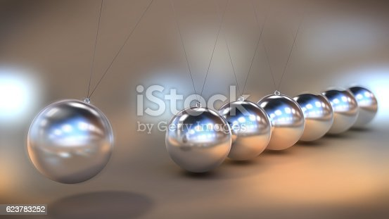921145928 istock photo Illustration of a Newton's cradle in close up view 623783252