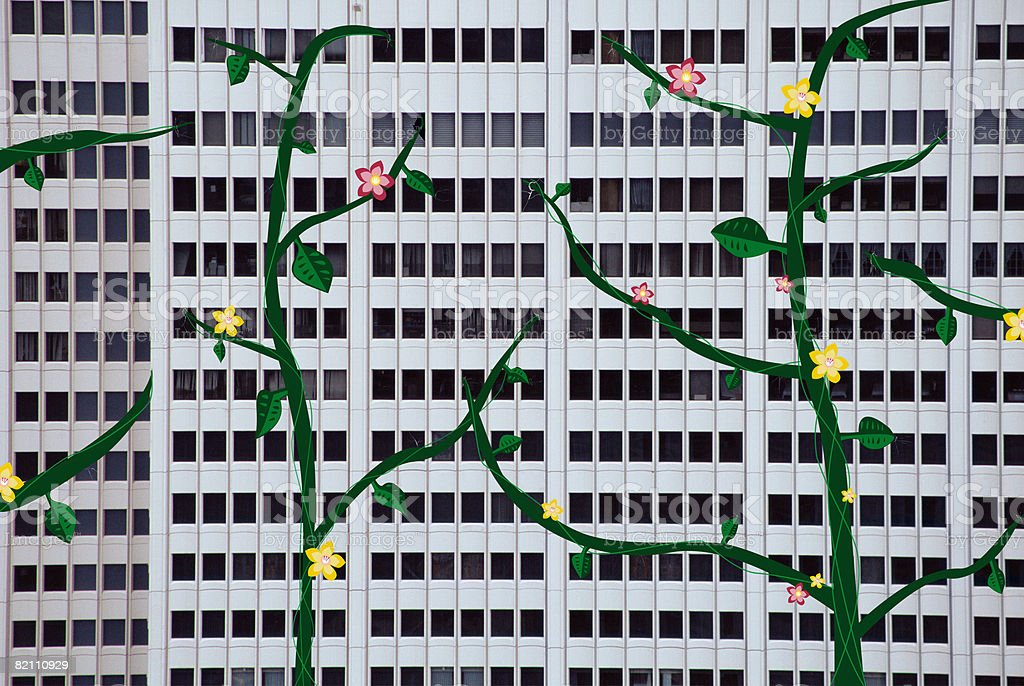 Illustration of a plant growing on a building stock photo